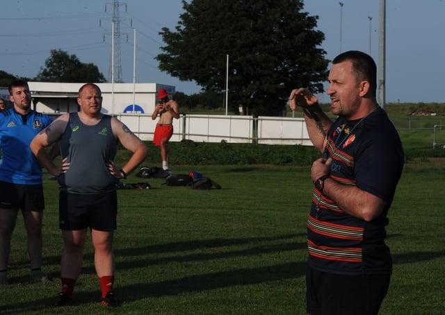 Borough coach Shane Manning (right).