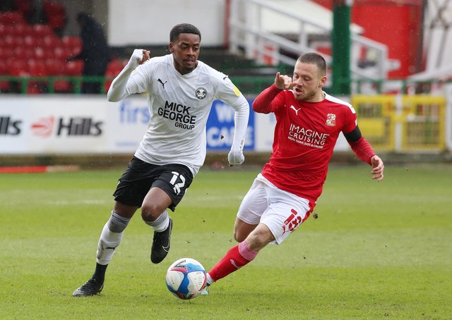 Reece Brown of Peterborough United in action with Jack Payne of Swindon Town. Photo: Joe Dent/theposh.com.