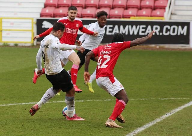 Jonson Clarke-Harris of Peterborough United scores his sides third goal of the game against Swindon Town. Photo: Joe Dent/theposh.com.