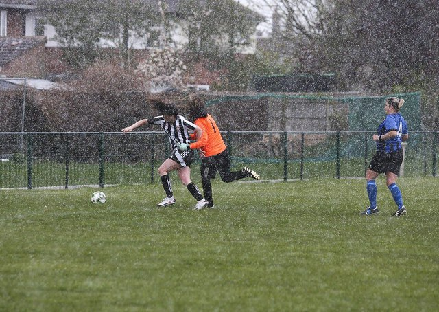 Jess Driscoll scores in the snow for Peterborough Northern Star Ladies against Whittlesey Athletic. Photo: Tim Symonds.