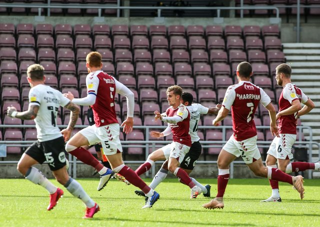 Nathan Thompson (hidden) scores for Posh at Northampton at Sixfields in October.