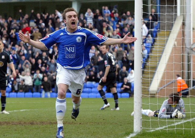 Charlie Lee celebrates a match-winning goal for 10-man Posh against Cobblers at London Road in 2009.