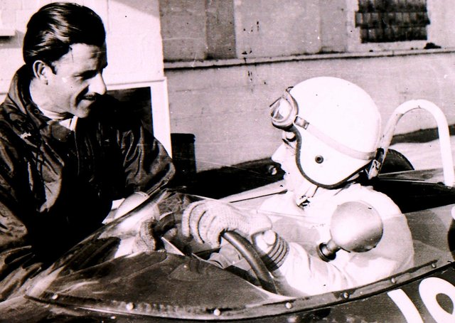 Formula 1 world champion Graham Hill shares a few racing tips at the Folkingham test site back in the sixties. EMN-210416-151006001