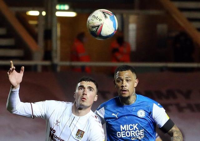 Jonson Clarke-Harris of Peterborough United closes down Lloyd Jones of Northampton Town. Photo: Joe Dent/theposh.com.