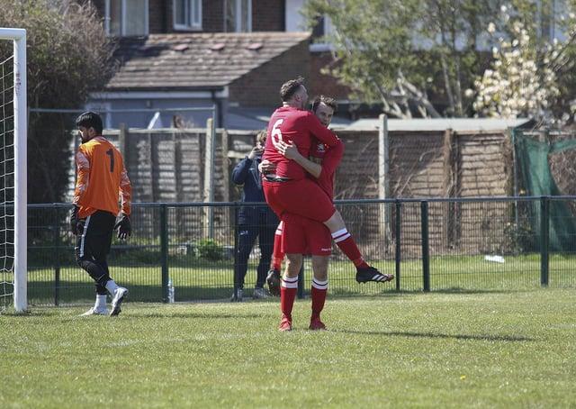Luke Steele (far) celebrates a goal for Peterborough Northern Star Reserves against FC Peterborough. Photo: Tim Symonds.