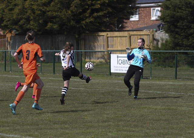 Georgia Clarke scores for Peterborough Northern Star Reserves against St Ives. Photo: Tim Symonds.