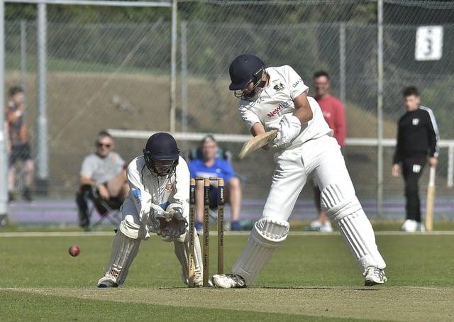 Ace Peterborough Town batsman Josh Smith in action.