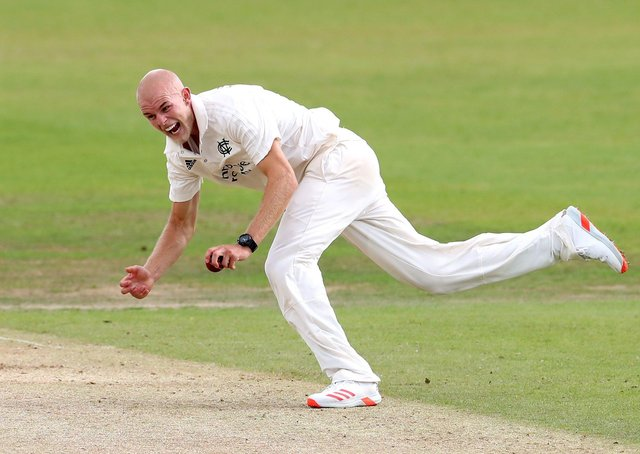 Zak Chappell takes a catch while playing for Notts. Photo: Martin Rickett PA.