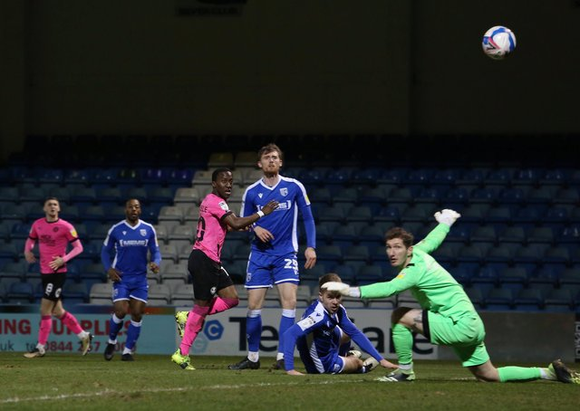 Siriki Dembele scores for Posh at Gillingham earlier this season.