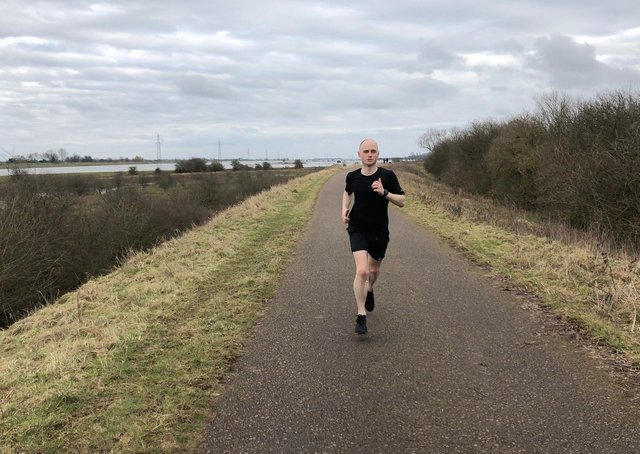 Lee Whitton running to help tackle climate change.