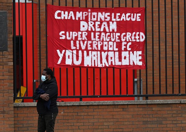 Banners critical of the European Super League project  hang from the railings of Anfield stadium, home of English Premier League football club Liverpool. (Photo by PAUL ELLIS/AFP via Getty Images)