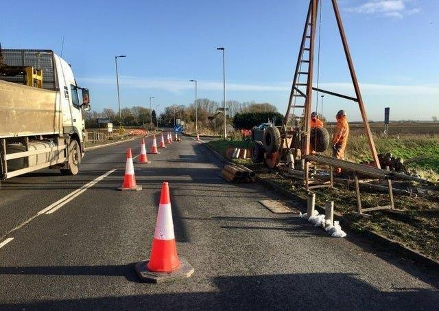 Workers at the A605