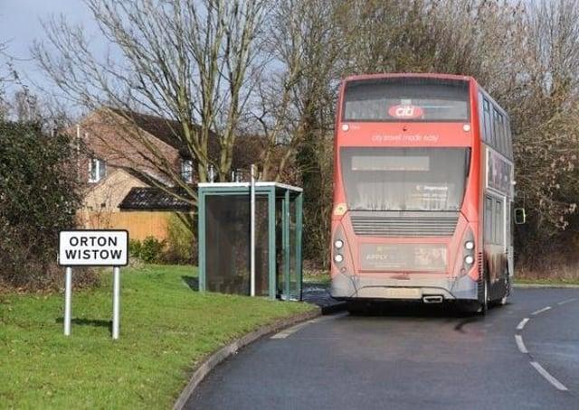 A bus stopped near Linnet in Orton Wistow.