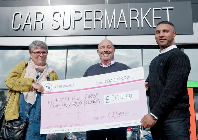 Cherry Lester from Families First Peterborough receives a cheque from SW Car Supermarket.
