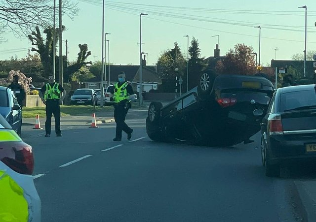 An overturned car on Welland Road yesterday.