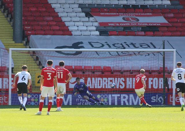 Posh goalkeeper Josef Bursik saves a penalty from Charlton's Jayden Stockley. Photo: Joe Dent/theposh.com.
