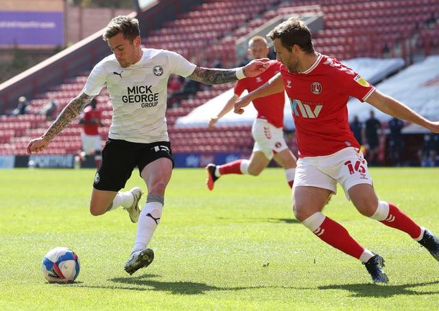 Sammie Szmodics of Peterborough United in action against Adam Matthews of Charlton Athletic. Photo: Joe Dent/theposh.com.