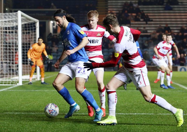 George Boyd in action for Posh with Kieran Sadlier (right) of Doncaster at London Road last season.