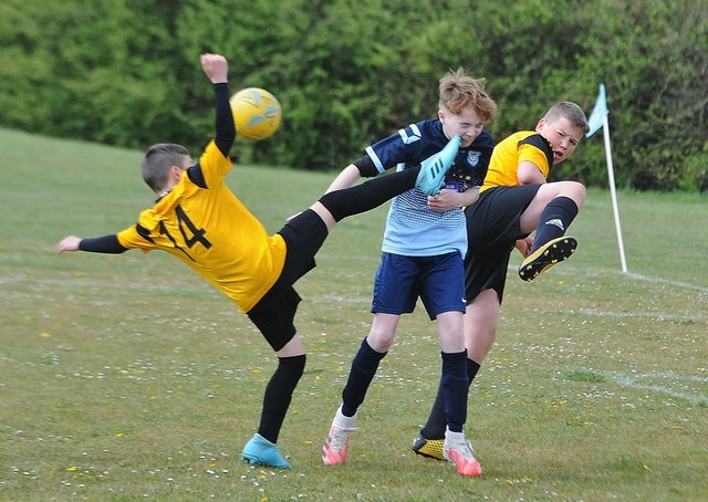 Action from Gunthorpe Harriers (blue) v Boston in the Junior Alliance Under 12 Hereward Cup. Gunthorpe won an excellent contest 4-3 with  Zack Goodrum, Oscar Hirst and Demi Gilbert among the goalscorers. Photo: David Lowndes.