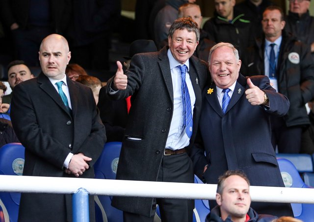 Peterborough United Co-owner Dr Jason Neale (centre) in the stands with Director of Football Barry Fry.