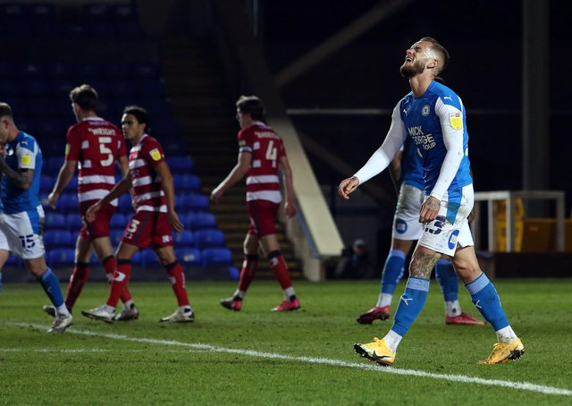 Joe Ward of Peterborough United cuts a frustrated figure during the draw with Doncaster Rovers. Photo: Joe Dent/theposh.com.