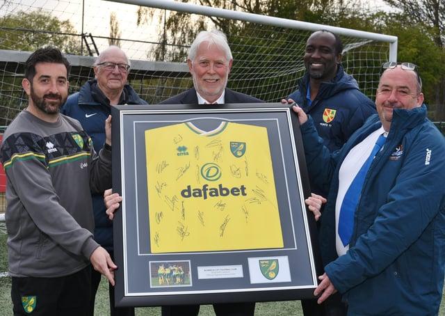 Yaxley FC sign up with Norwich FC Academy, from left, Alex Kaufman, MD of Norwich FC regional development programme, Lawrie Cooke (Hunts FA), Jeff Lenton (President of Yaxley FC), Dee Walker (Hunts FA), Malcolm Clements (Chairman of Yaxley FC). Photo: David Lowndes.