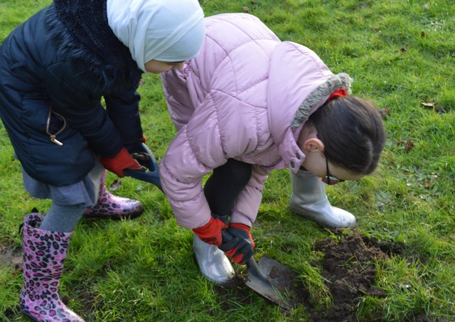 Pupils at Northborough Primary School in the school grounds