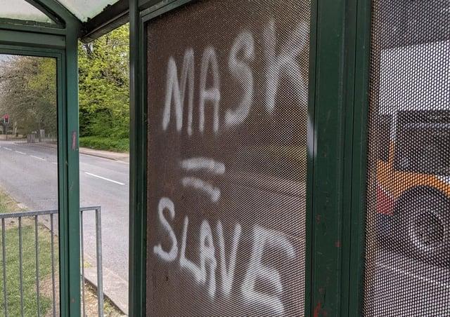 Graffiti on a bus stop in Orton Longueville.