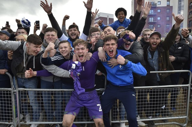Posh players, staff and fans celebrate outside the Weston Homes Stadium after promotion  to the Championship was clinched in dramatic style. Pictures: David Lowndes.