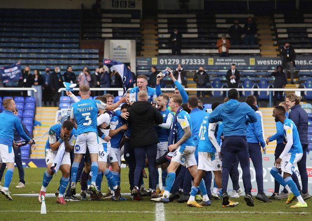 Posh players celebrate promotion after the draw with Lincoln. Photo: Joe Dent/theposh.com.