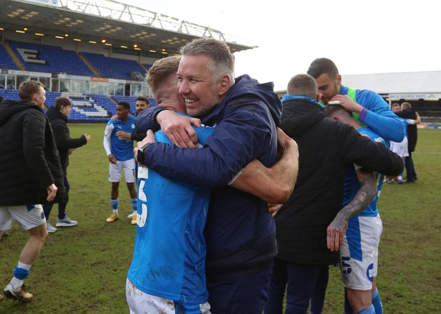 Peterborough United Manager Darren Ferguson celebrates winning promotion with Dan Butler. Photo: Joe Dent/theposh.com.