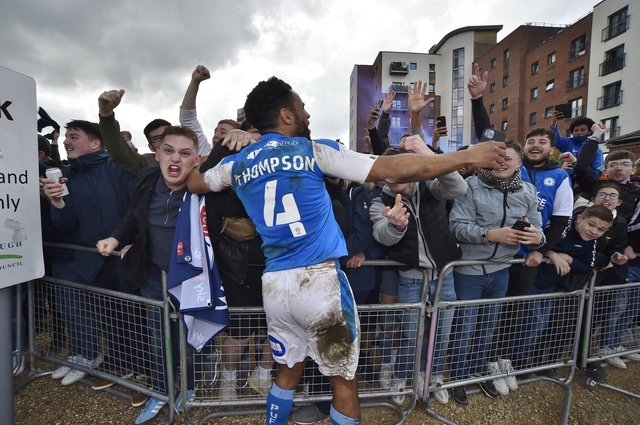 Posh drew with Lincoln City to gain promotion to the Championship triggering huge celebrations with fans outside the Weston Homes Stadium. Pictures: David Lowndes