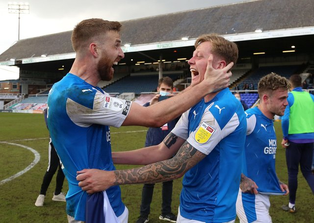 Mark Beevers and Frankie Kent of Peterborough United celebrate winning promotion at full-time. Photo: Joe Dent/theposh.com.