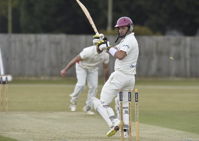 Peterborough Town skipper David Clarke is bowled for 13 by former teammate Danny Mohammed during a drawn game with Brigstock. Photo: David Lowndes.