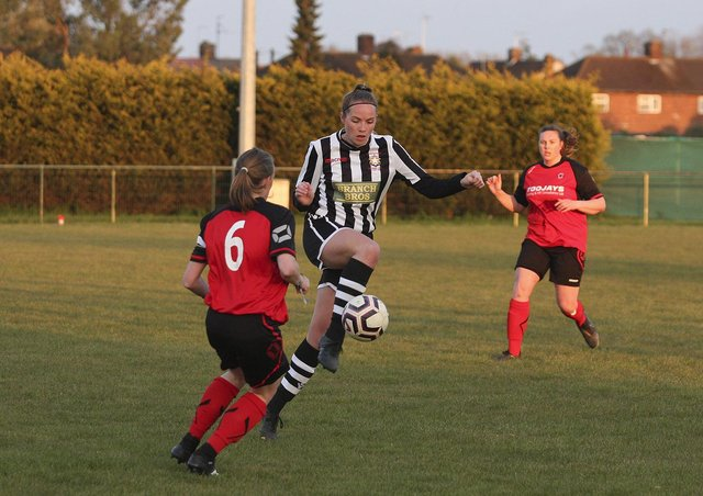 Jess Evans (stripes) in action for Peterborough Northern Star Reserves against Netherton. Photo: Tim Symonds.