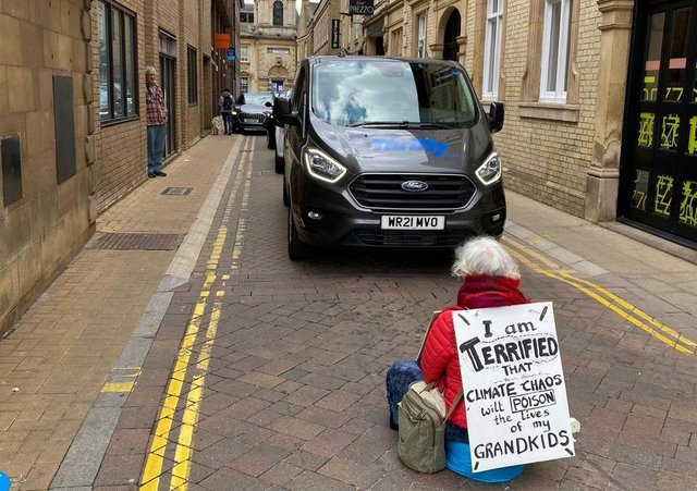 Lorna (72) during her protest on Cowgate on Saturday (May 1).