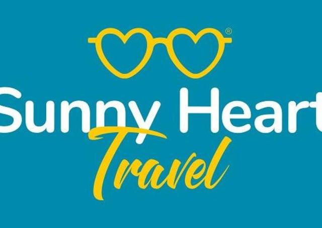 The logo for Sunny Heart Travel.