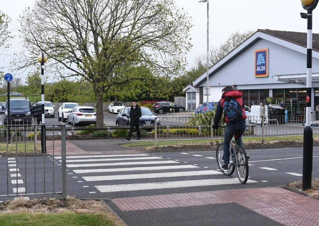 The crossing outside Aldi along the A605.