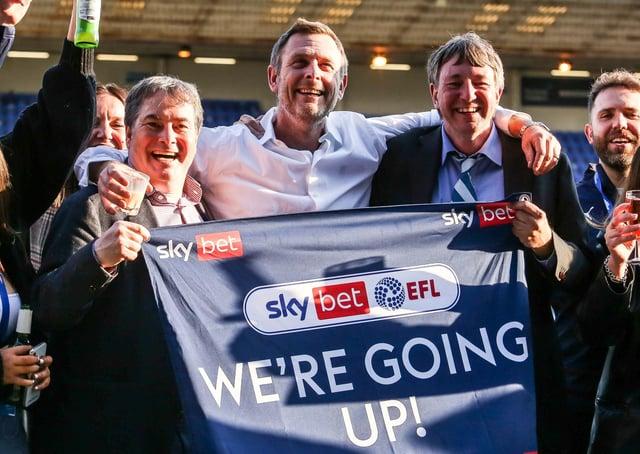 Posh co-owners, from left, Stewart Thompson, Darragh MacAnthony and Jason Neale celebrate winning promotion. Photo: Joe Dent/theposh.com.