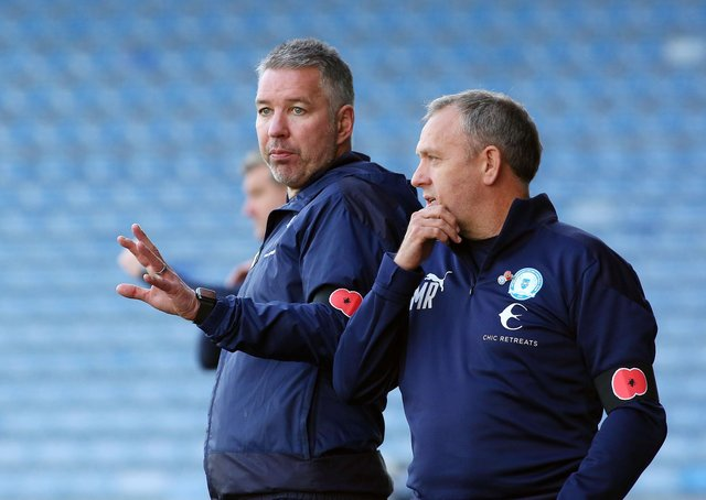 Posh assistant manager Mark Robson (right) with first-team boss Darren Ferguson.