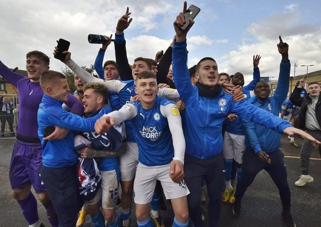 Harrison Burrows (front, centre) leads Posh promotion celebrations. Photo: David Lowndes.