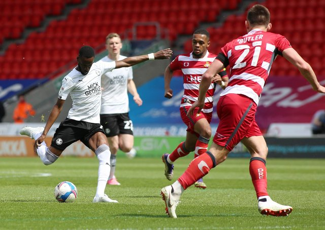 Mo Eisa of Peterborough United scores the opening goal of the game against Doncaster Rovers. Photo Joe Dent/theposh.com.