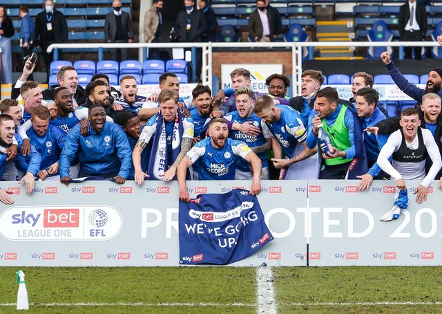 At last Posh players and staff can celebrate promotion! Darragh MacAnthony is back row on the left. Photo: Joe Dent/theposh.com.