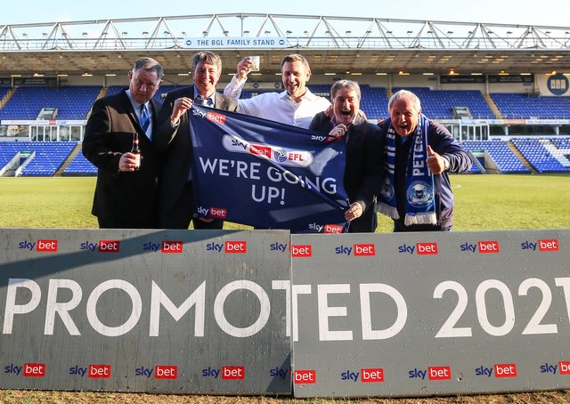 Poosh officials and owners celebrate promotion, from left, Bob Symns (chief executive officer), Dr Jason Neale (co-owner), Darragh MacAnthony (co-owner), Stewart Thompson)(co-owner) and Barry Fry (director of football). Photo: Joe Dent/theposh.com.