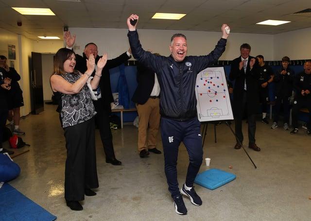 Posh boss Darren Ferguson celebrates a great season in the Doncaster Rovers dressing room after the final match. Photo: Joe Dent/theposh.com.