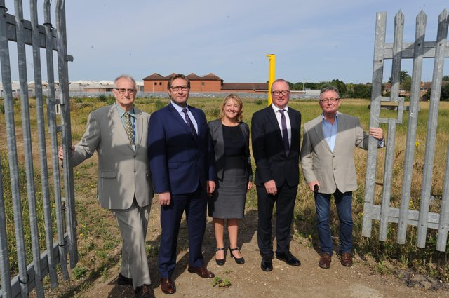 Council leader Cllr John Holdich, former mayor James Palmer, Sarah Ireland and Michael Heekin from Cross Keys Homes and Cllr Peter Hiller at the site of the first development off Newark Road. Photo taken pre-Covid pandemic EMN-170717-163108009