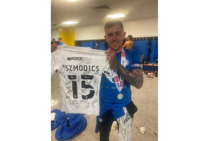 Sammie Szmodics with the signed shirt he is auctioning off.