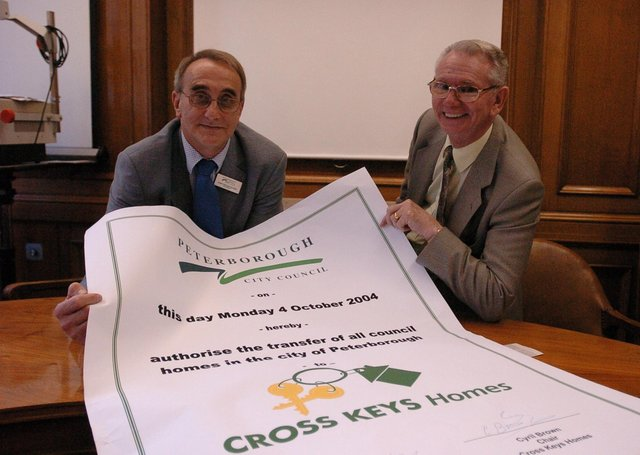 John Holdich (left) at the handover of council houses to Cross Keys Homes