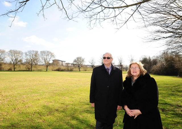 John Holdich and cabinet member Lynne Ayres at the site of the new university