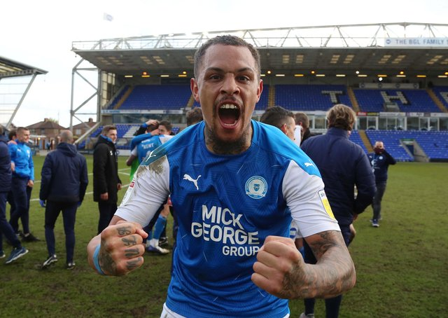 Posh striker Jonson Clarke-Harris celebrates promotion.